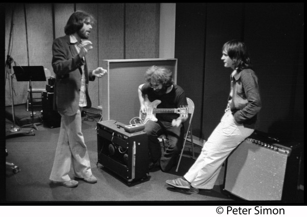 Grateful Dead in the studio (Automated Sound): Right to left: Keith Olsen (producer, seated on amplifier), Jerry Garcia (seated, paying guitar), Bob Weir: , ca. 1977