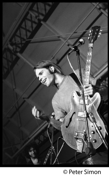 Bob Weir, with guitar, Grateful Dead concert, MIT: Jerry Garcia in the background: , ca. May 7, 1970