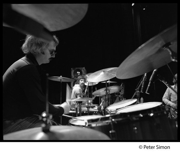 Bill Kreutzman (Grateful Dead) playing drums in concert: Mickey Hart visible in background: , ca. 1977