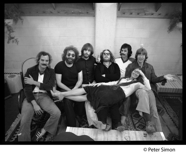 Grateful Dead group shot: Left to right: Bill Kreutzman,Jerry Garcia,  Bob Weir, Keith Godchaux, Mickey             Hart, and Phil Lesh, with Donna Jean Godchaux stretched across their laps: , ca. 1977