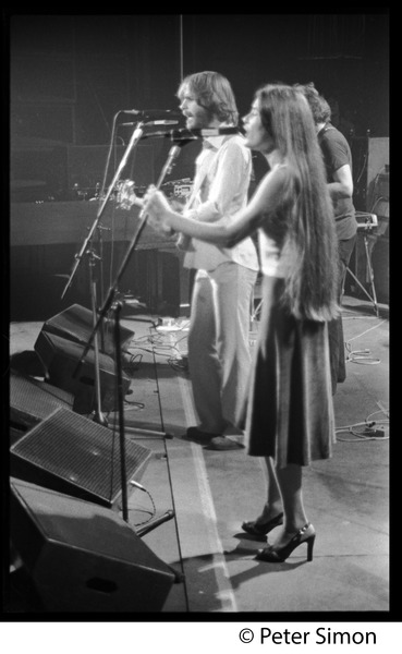 Grateful Dead on stage: Left to right: Bob Weir, Donna Godchaux singing: , ca. 1977