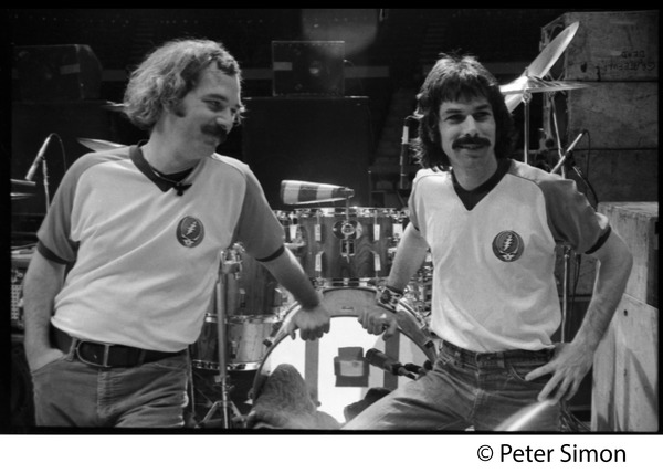 Bill Kreutzman (left) and Mickey Hart, drummers for the Grateful Dead, standing             in front of their kit, ca. 1977