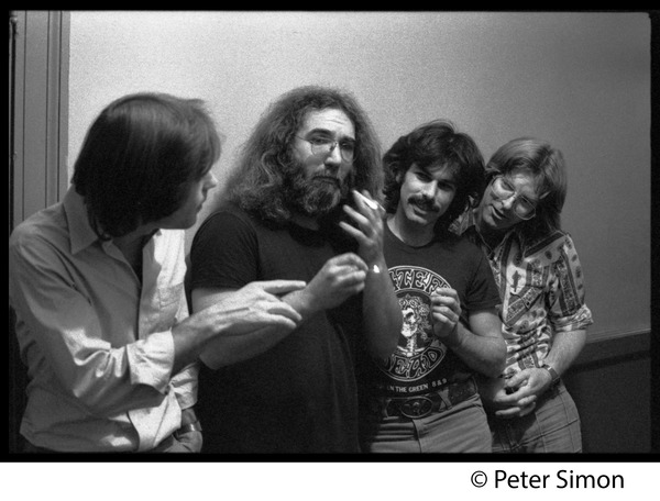 Grateful Dead backstage (left to right): Bob Weir, Jerry Garcia, Mickey Hart, and Phil
