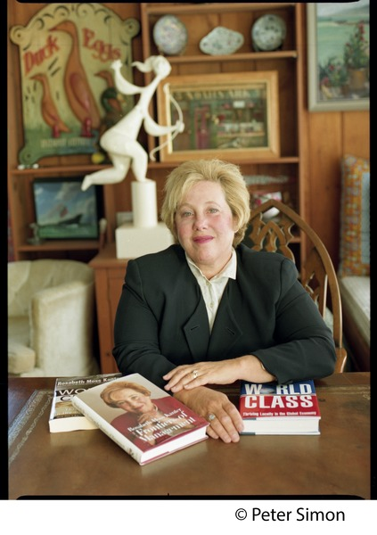 Rosabeth Moss Kanter, seated at a table with her books, ca. 1997