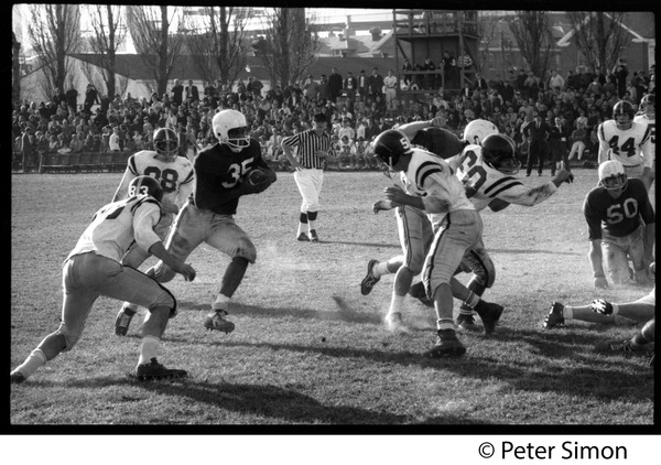 Tacklers closing in on running back, ca. 1967