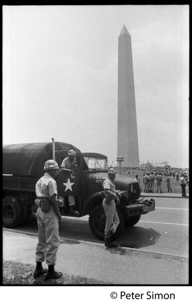 National guardsmen and truck at the ready during the March on the Pentagon (mobilization on             Washington), the Washington Monument in the background, ca. October 21, 1967