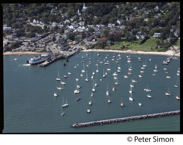 Aerial view of the harbor at Vineyard Haven, Marthas Vineyard, with the M/V             Islander in the dock, ca. 1980