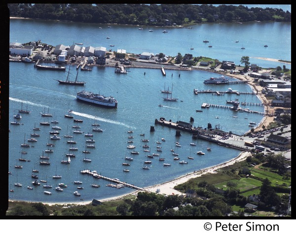 Aerial view of the harbor at Vineyard Haven, Marthas Vineyard, with the M/V             Islander nearing the dock, ca. 1980
