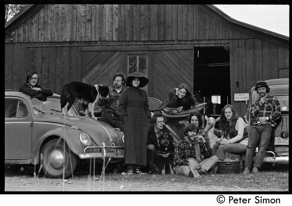 Commune members gathered around their vehicles outside the barn, Packer Corners             commune: Group includes: Raymond Mungo (far left) and Michael Gies (far right) and             seated (l. to r.) John Wilton, Elliot Blinder, Verandah Porche, and Lacey Mason: , ca. 1968