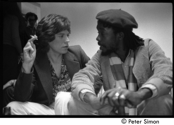 Mick Jagger and Peter Tosh sharing a marijuana cigarette backstage during an appearance on Saturday Night Live, ca. December 16, 1978