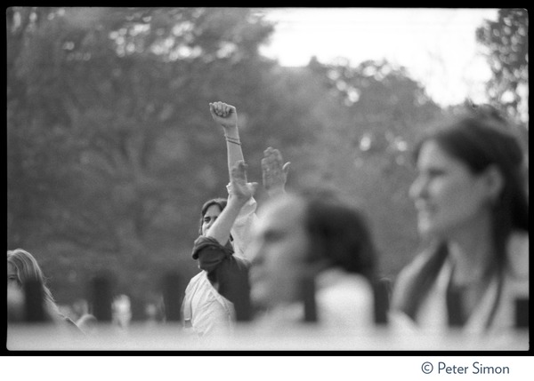 Audience member at the No Nukes concert and protest, raising a fist, May 6, 1979