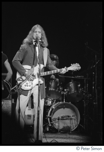 T-Bone Burnett playing Rickenbacker guitar on stage at the Harvard Square Theater,             Cambridge, with the Rolling Thunder Revue, November 1975