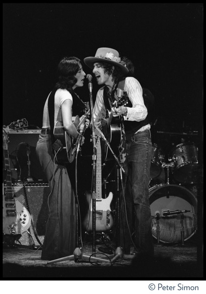 Joan Baez and Bob Dylan sharing a microphone, performing at the Harvard Square Theater,             Cambridge, with the Rolling Thunder Revue, November 20, 1975