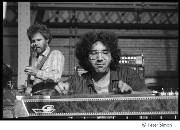 Jerry Garcia playing pedal steel and David Nelson (New Riders of the Purple Sage) performing on stage at Dupont Gym, MIT, May 7, 1970