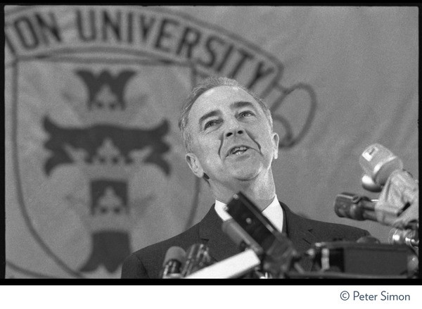 Sen. Eugene McCarthy speaking at Sargeant Gymnasium, Boston University: Close-up of McCarthy speaking at a podium, head tilted back, behind a raft of microphones: , April 10, 1968