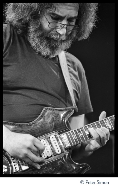 Jerry Garcia, playing guitar in concert with the Grateful Dead, Radio City Music Hall: Close-up portrait: , October 25, 1980
