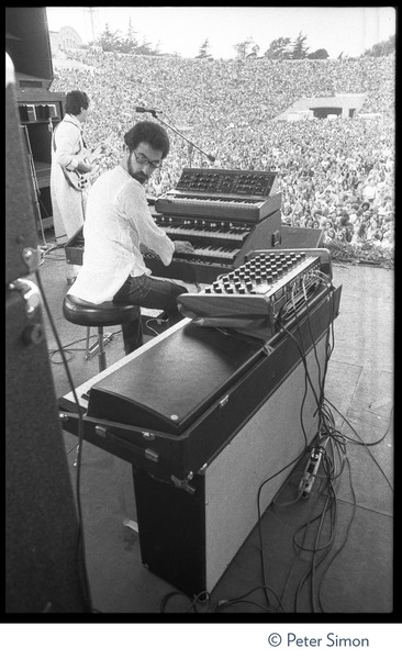 Carlos Santana performing at Bill Graham's SNACK (Students Need Athletics,             Culture and Kicks) benefit concert, Kezar Stadium, wih keyboard player Tom Coster, ca. March 1975