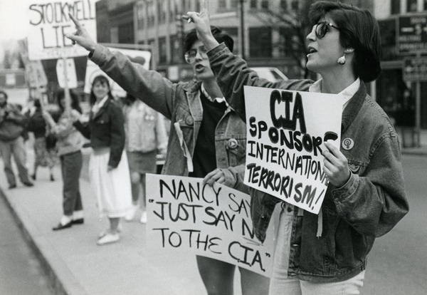Anti-CIA protesters in Northampton with placards reading 'CIA sponsors             international terrorism;' 'Nancy just say no to the CIA,' and 'Stockwell lies', ca. April 1987