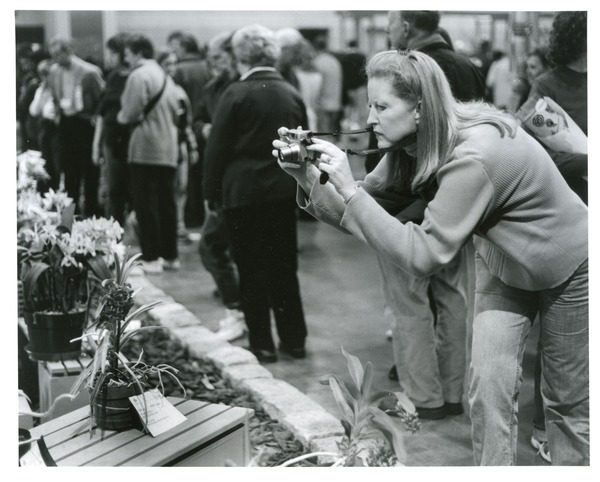 Intent woman snaps flower show, 2004, March 16, 2004