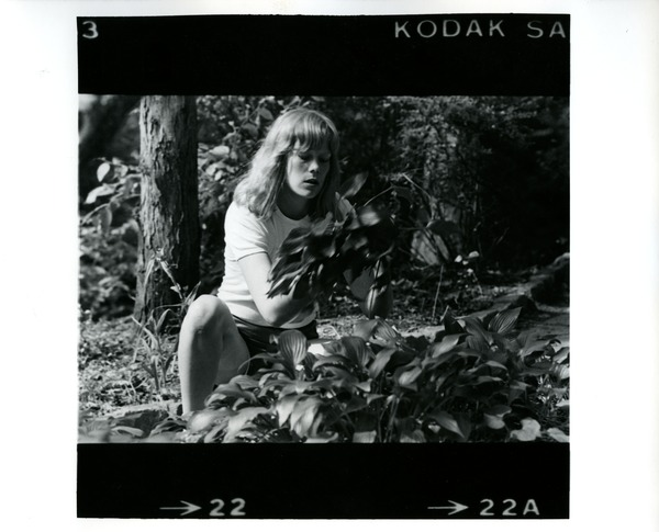 Woman and plants, ca. 1975