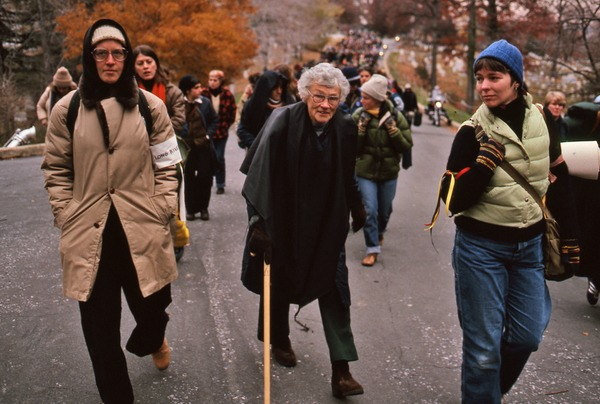 Senior with a cane walking with demonstrators, November 1980