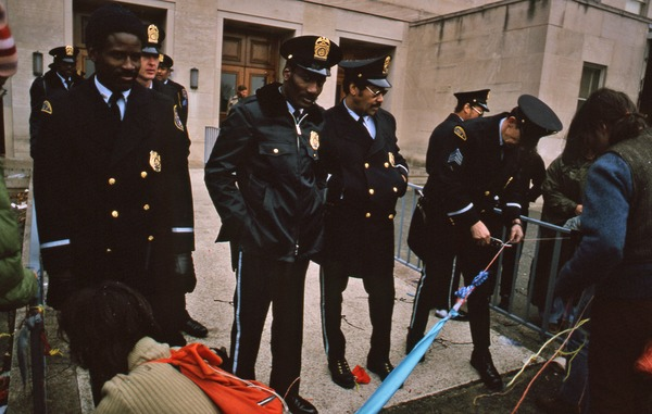 Pentagon Building police cut fabric blocking the entrance, November 1980