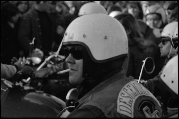 Draft rally in Wakefield: Descendents motorcycle club member smoking, October 29, 1967