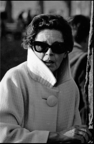 Draft rally in Wakefield: woman in coat and sunglasses, October 29, 1967