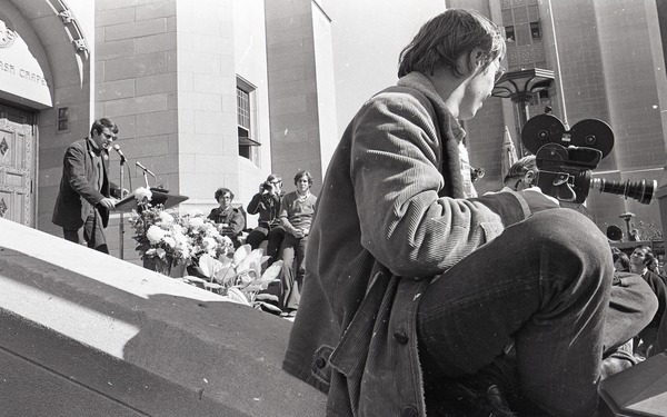 Moratorium to End the War in Vietnam: man speaking on steps of Marsh Chapel at Boston University, October 15, 1969