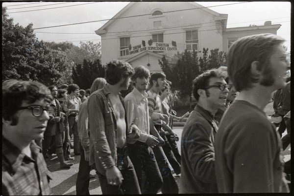 Antiwar demonstration at Fort Dix, N.J.: line of protesters marching past             Christian Serviceman's Center, October 12, 1969