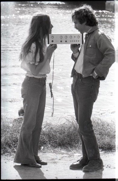 Lacey Mason and Elliot Blinder holding stereo equipment, 1969