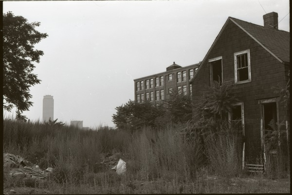 Roxbury rambling: overgrown lot in front of abandoned house, Prudential Center