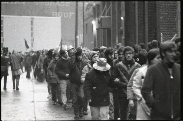 MIT I-Lab demonstration: protesters marching by Instrumentation Laboratory, February 1970
