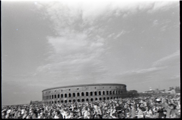 Anti-war rally at Soldier's Field, Harvard University: crowd in front of Harvard Stadium, ca. May 8, 1970
