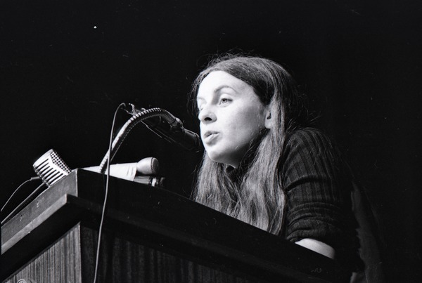 Bernadette Devlin McAliskey at the podium during a talk at Northeastern University, February 18, 1971