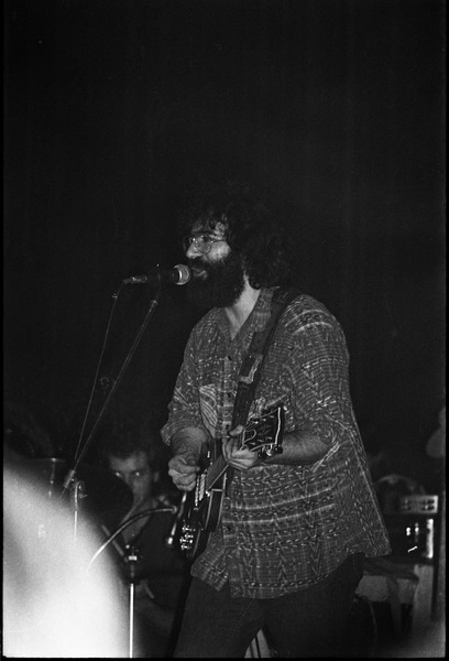 Grateful Dead performing at the Music Hall: Jerry Garcia onstage, playing guitar and singing, April 1971