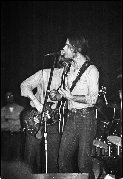 Grateful Dead performing at the Music Hall: Bob Weir singing with Phil Lesh in background, April 1971
