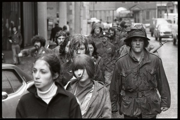 Vietnam Veterans Against the War demonstration 'Search and destroy': veterans             leading 'prisoners of war' down State Street, Old State House in background, ca. April 14, 1971