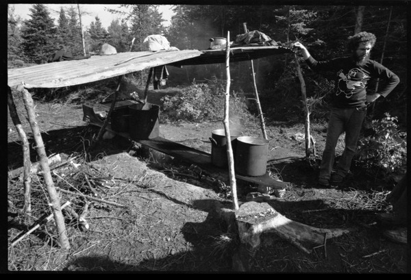 Man standing by a makeshift shelter, Earth People's Park, ca. September 1971