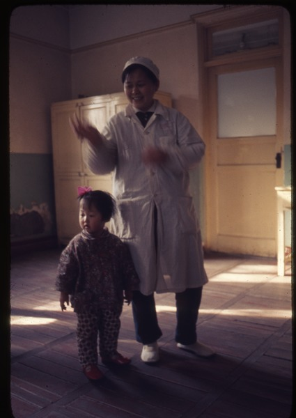 Cotton Mill No. 2: child and adult in day care center, March 19, 1977