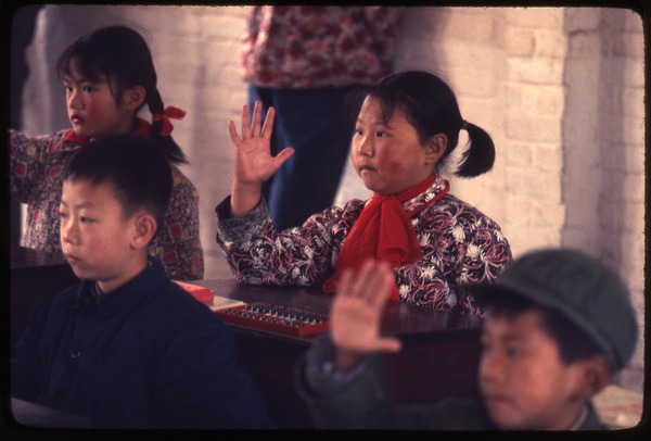 Hsiao Ying Primary School -- four children, girl waving hand, March 24, 1977