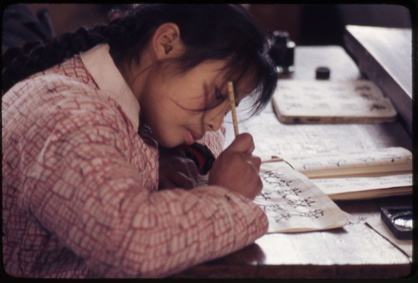 Hsiao Ying Primary School -- girl doing calligraphy, March 24, 1977