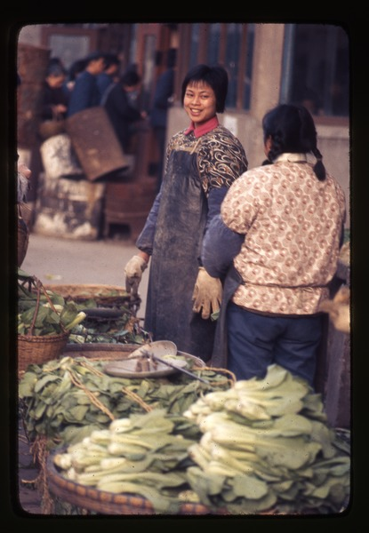 Young woman selling green vegetables, March 25, 1977