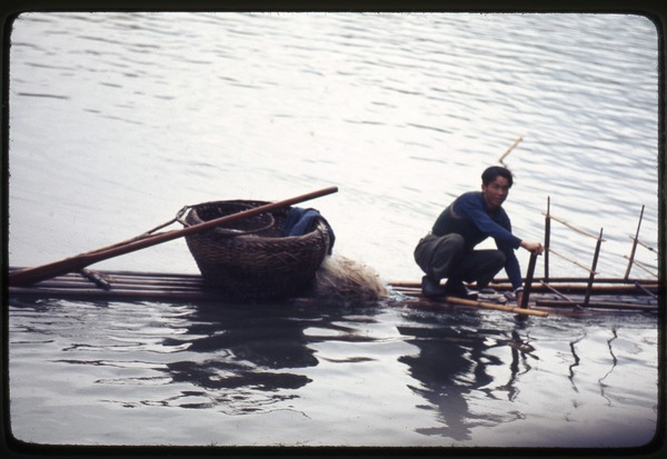 Fisherman on bamboo boat, April 5, 1977