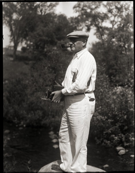 Judge Nelson P. Brown taking a photograph, ca. 1935