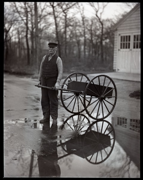 Otis Fish, the blind clam digger of Falmouth, with his pull cart, ca. 1925