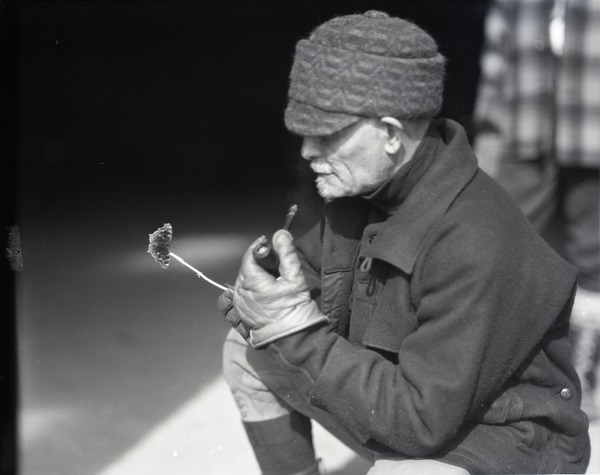 Franklin I. Jordan, looking a moth and smoking a pipe, ca. 1935