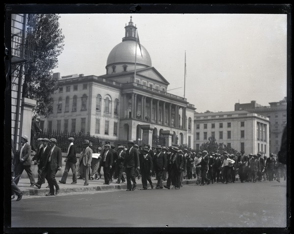 Protesters supporting Sacco and Vanzetti marching in front of the Massachusetts State House, ca. 1927