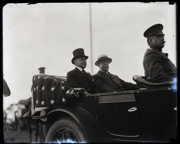 William Howard Taft and Gov. Channing Harris Cox (l. to r.), riding in touring          car, ca. 1925