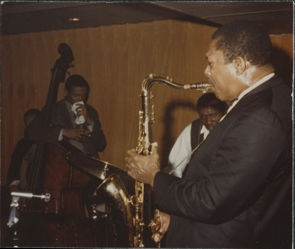 John Coltrane (soprano saxophone) with Jimmy Garrison (double bass) and Elvin       Jones (drums) on stage at the Jazz Workshop, ca. 1964
